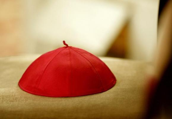 A cardinal's cap lies on a chair during a ceremony in St. Peter's Basilica presided over by Pope Joh..