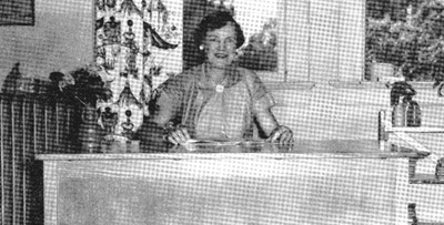 Mrs Thelma Miller in the first grade room in 1953. The curtains were made and put up by the home room mothers, Arley Baldwin and Mary Dewees.