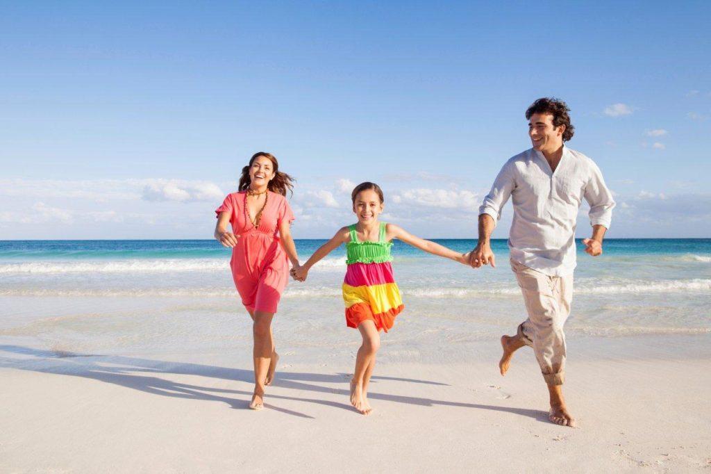Family on beach iStock